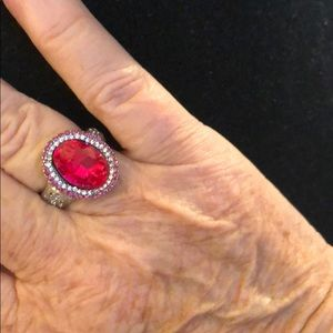 Silver tone/red stone fashion ring.